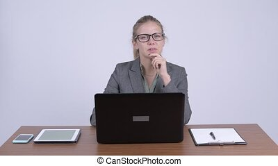 Young beautiful blonde businesswoman talking at work