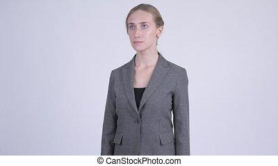 Young beautiful blonde businesswoman thinking - Studio shot...