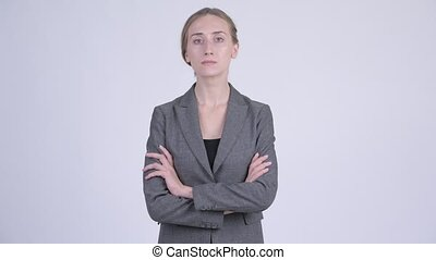 Young beautiful blonde businesswoman with arms crossed