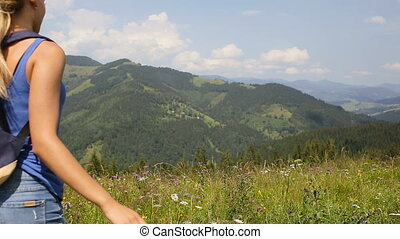 Young beautiful blonde girl posing in the mountains.