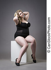 Young beautiful blonde plus size model in shapewear, xxl...