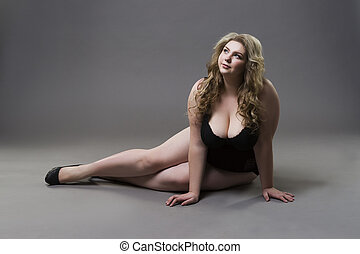 Young beautiful blonde plus size model with big natural...