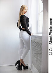 Young beautiful blonde posing