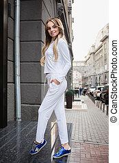 Young beautiful blonde posing outdoors