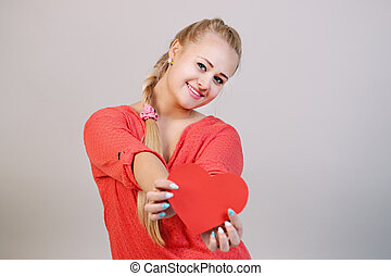 blonde woman holding a heart