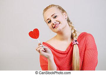 woman holding a lollipop