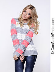 blonde woman in jeans and sweater