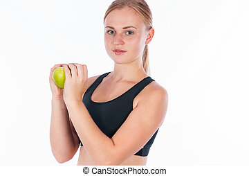 young beautiful blonde woman with a green apple in her hand