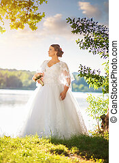Young beautiful bride in nature