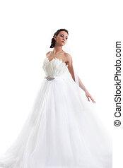 Young beautiful bride posing in fashionable dress