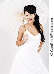 Young beautiful bride with white umbrella