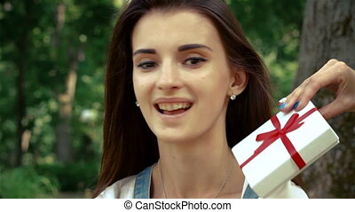 young beautiful brunette holding a gift