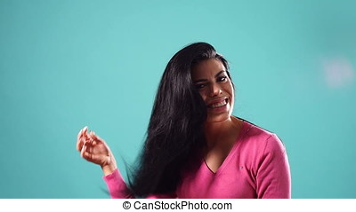 Young beautiful Brunette Model Smiling Touching Hair on...