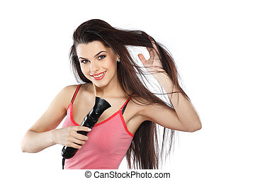 young, beautiful brunette with a hair dryer