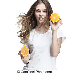 young beautiful brunette woman holding orange