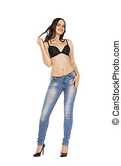 Young beautiful brunette woman in blue jeans