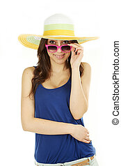 Young beautiful brunette woman in summer hat and glasses on white background