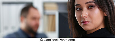 young beautiful brunette woman sit at table in office in cabinet of her boss