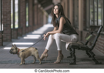 brunette woman sitting with dog