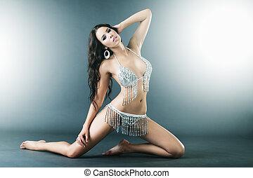 Young beautiful brunette woman wearing sexy bikini
