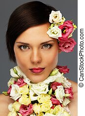 Young beautiful brunette woman with flower collar