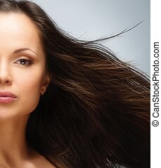 Young beautiful brunette woman with brown eyes and long...