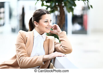 Young beautiful business woman in cafe