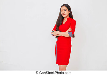 Young beautiful business woman in red dress