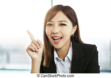 young beautiful business woman showing and pointing