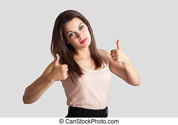 Young beautiful business woman showing thumb up