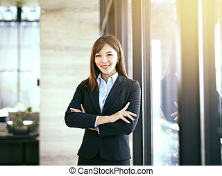 young beautiful business woman standing in office