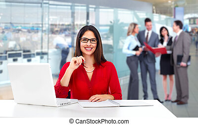 Young beautiful business woman with laptop.