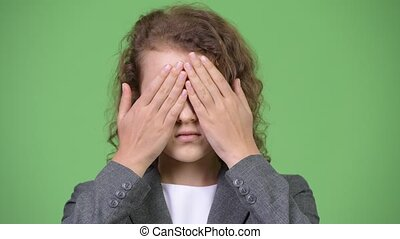 Young beautiful businesswoman covering eyes as three wise...