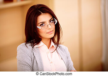 Young beautiful businesswoman in glasses