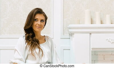 Young beautiful businesswoman in white clothes.