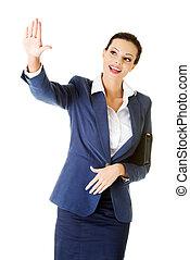 Young beautiful businesswoman making choose