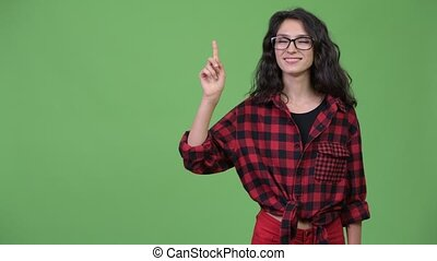 Young beautiful businesswoman pointing up
