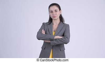 Young beautiful businesswoman with arms crossed - Studio...