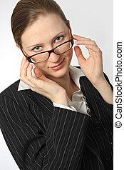 Young beautiful businesswoman with glasses