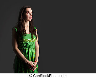 young beautiful caucasian brunette in dress