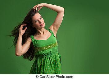 young beautiful caucasian brunette in green dress