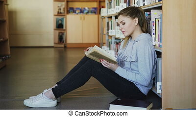 Young beautiful caucasian female student in casual clothing...