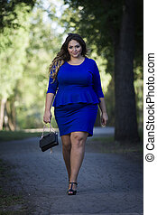 Young beautiful caucasian plus size fashion model in blue ...