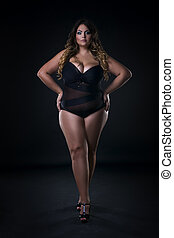 Young beautiful caucasian plus size model in swimsuit, xxl...