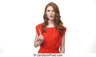 Young beautiful caucasian woman in gorgeous orange dress standing and say no isolated over white background while looking camera.
