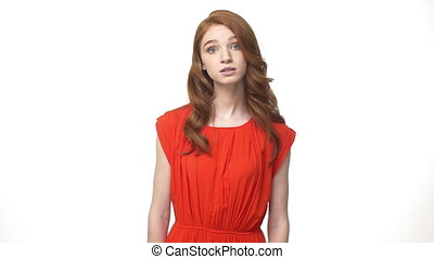 Young beautiful caucasian woman in gorgeous orange dress...