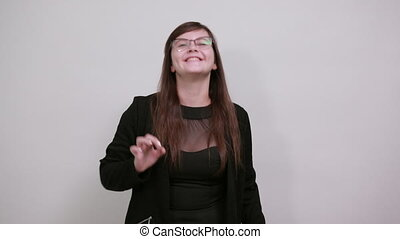 Young beautiful caucasian woman showing ok sign gesture wearing black clothes on isolated gray background