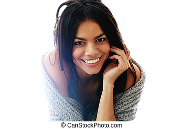 Young beautiful cheerful woman sitting isolated on a white background