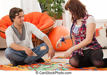 Young beautiful couple at home