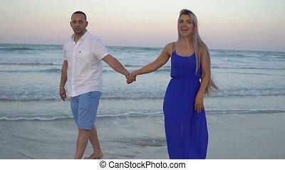 young beautiful couple - beautiful couple walking on the...